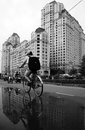 Young boy ride bicycle with high rise building background ho chi minh viet nam dec on street class the reflect on Stock Photography