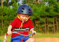 Young Boy Riding Bike Stock Images
