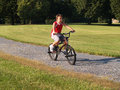 Young boy riding a bike Stock Image