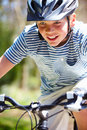 Young boy riding bike along country track close up of wearing helmet Stock Images