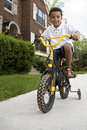Young boy riding his bicycle Royalty Free Stock Photos