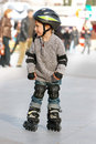 Young boy rollerskating Royalty Free Stock Image