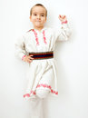 Young boy dancing in romanian traditional clothes