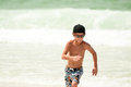 Young Boy Running in Ocean Royalty Free Stock Image