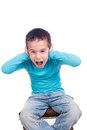 Young boy screaming child or with hands over his ears Royalty Free Stock Image