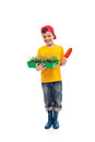 Young boy with seedlings ready for gardening tomato in a tray isolated Royalty Free Stock Image