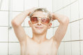 Young boy showering in sunglasses Royalty Free Stock Photo