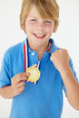 Young boy showing off medal Royalty Free Stock Photo