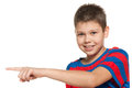Young boy shows her finger to the side a on white background Royalty Free Stock Photos