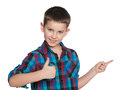 Young boy shows his finger aside a with thumb up on the white background Stock Photo
