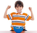 Young boy shows his strength by raising his arms Stock Photo