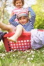 Young Boy Sitting In Laundry Basket Stock Image