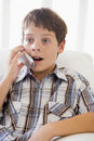 Young Boy Sitting On A Sofa Royalty Free Stock Images