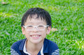 Young boy smiling in park Royalty Free Stock Photo