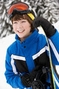 Young Boy With Snowboard In Mountains Royalty Free Stock Photo