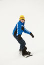 Young Boy Snowboarding Down Slope On Holiday Royalty Free Stock Photo