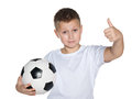 Young boy with soccer ball a smiling holds his thumb up on the white background Royalty Free Stock Photos