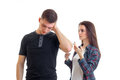A young boy stands near a beautiful girl tilted her head and closed ear hand Royalty Free Stock Photo