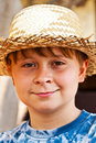 Young boy with straw hat is happy and smiles Stock Image