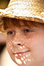 Young boy with straw hat is happy and smiles Royalty Free Stock Photos