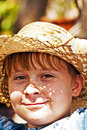 Young boy with straw hat is happy and smiles Royalty Free Stock Photo