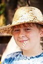 Young boy with straw hat is happy and smiles Royalty Free Stock Photography
