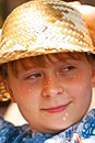 Young boy with straw hat is happy and smiles Stock Photos
