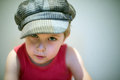 A young boy strong look in cap with Royalty Free Stock Photos