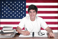 Young boy student on the background with american flag americanl english language learning concept Royalty Free Stock Image