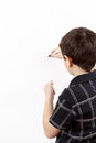 Young boy student in a writing on a whiteboard classroom empty Stock Photography