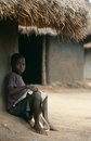 A young boy studying outside his hut, Uganda. Stock Image