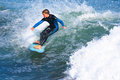 Young boy surfing santa cruz california surfer kid sam coffey at steamer lane Royalty Free Stock Photography
