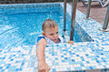 Young boy in swimming pool Stock Photos