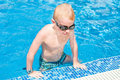 Young boy at swimming pool Royalty Free Stock Photo