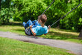 Young boy swinging kid at outdoor Stock Photos