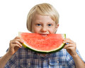Young boy taking bite of water melon a cute happy smiling biting into a big juicy slice watermelon isolated on white Royalty Free Stock Photos