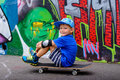 Young boy taking a rest at the skate park Royalty Free Stock Photo
