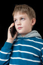 Young boy talking on mobile phone Royalty Free Stock Photo