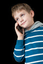 Young boy talking on mobile phone and smiling Royalty Free Stock Photo