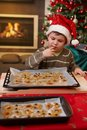 Young boy tasting christmas cake Royalty Free Stock Image