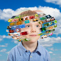 Young boy technology concept a has different media images around his head Stock Photo