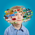 Young boy technology concept a has different media images around his head Royalty Free Stock Photo