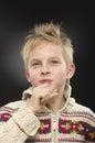 Young boy thinking, wondering on black background. Royalty Free Stock Photo