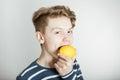 Young boy about to bite a fresh lemon Royalty Free Stock Photo