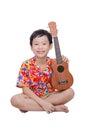 Young boy with ukulele over white Royalty Free Stock Photo