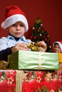 Young boy unwrapping Christmas gift Royalty Free Stock Photos