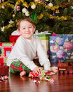 Young boy unwrapping presents Royalty Free Stock Photography
