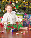 Young boy unwrapping presents Stock Images