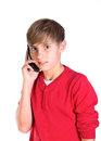 Young boy using mobile cell phone pre teen caucasian making call on telephone Royalty Free Stock Photos