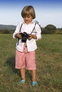 Young boy with vintage photo camera Stock Image